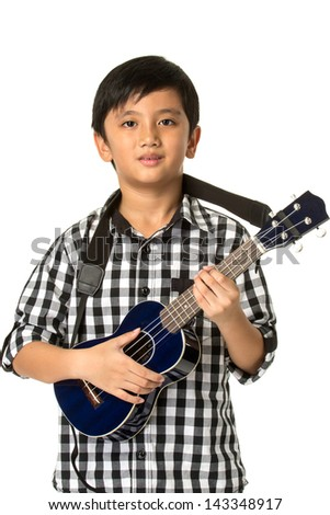 Boy playing guitar on white background. - stock photo