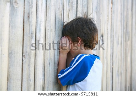 Boy Playing Hide and go Seek - stock photo