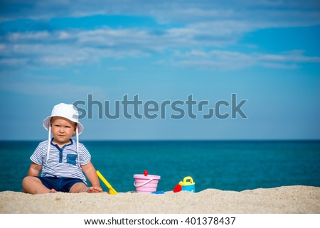 Boy playing on beach and space for text - stock photo