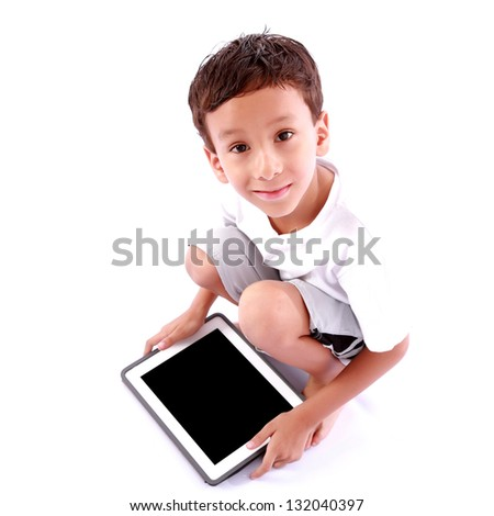 Boy playing on tablet over white background - stock photo