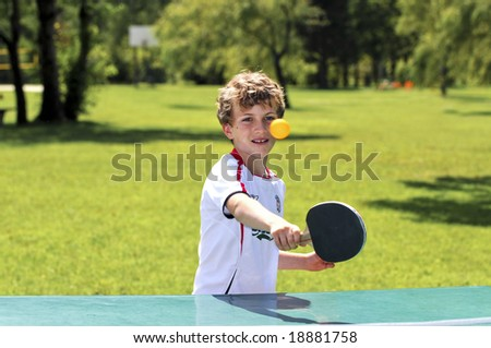 boy playing table tennis - stock photo