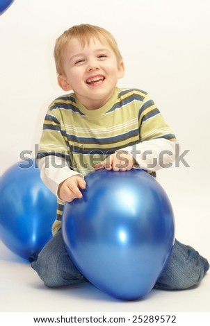 boy playing with balloons - stock photo