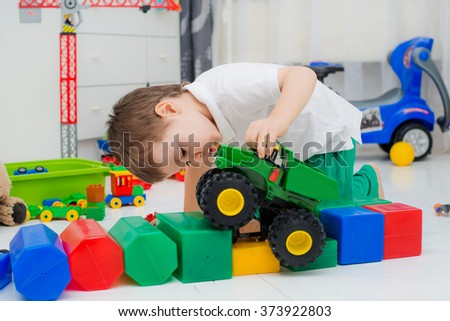 boy playing with car - stock photo