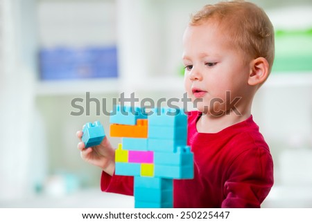 Boy playing with cubes - stock photo