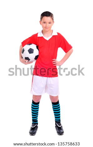 boy playing with football against white background - stock photo