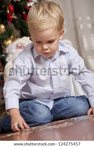 Boy playing with puzzle at christmas - stock photo