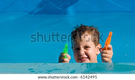 boy playing with squirt-guns - stock photo