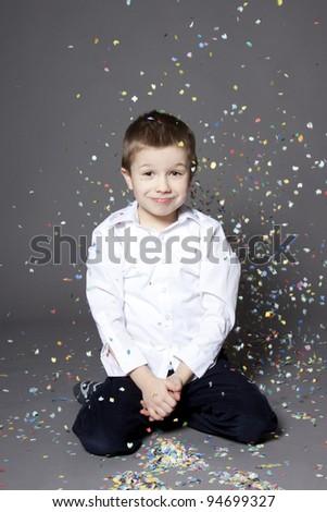 Boy portrait with confetti - stock photo