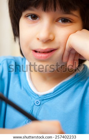 boy portrait with pen, close up - stock photo