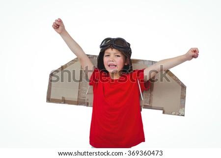 Boy pretending to be a pilot on white screen - stock photo