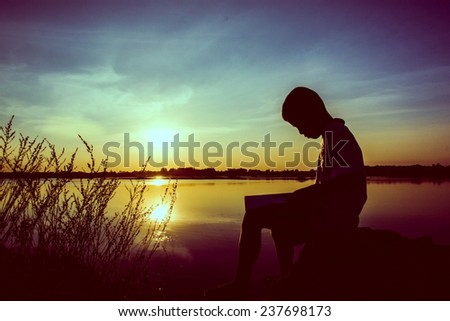 boy reading,silhouette concept - stock photo
