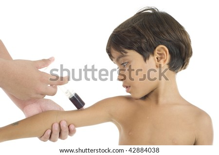 Boy receiving vaccine in the arm. - stock photo