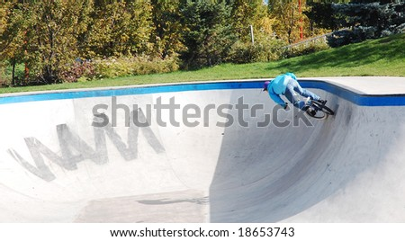 boy riding bmx bike at the skateboard park - stock photo