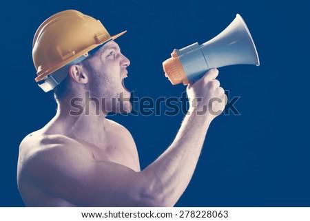 Boy screaming on the megaphone - stock photo