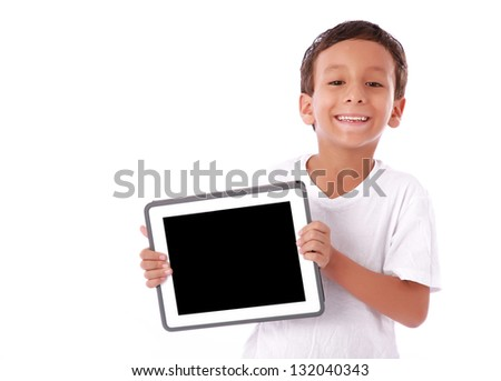 Boy showing a  tablet isolated over white background - stock photo