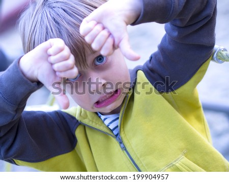 boy showing thumbs down - stock photo