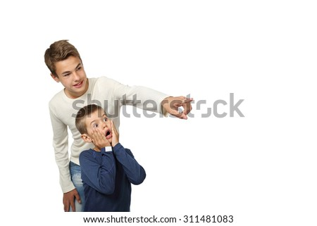 Boy shows something amazing to his little brother isolated on white background with copy space for text or advertising - stock photo