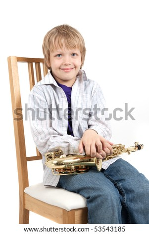 Boy sit on a chair - stock photo