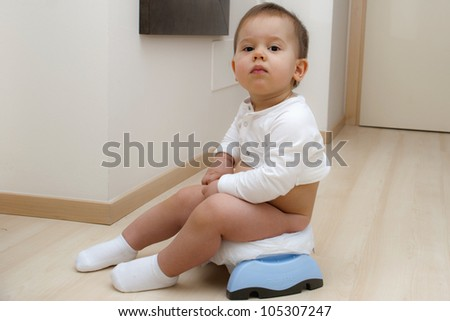 Boy sitting on a traveling potty - stock photo