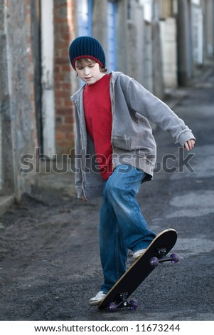 Boy skateboarding - stock photo