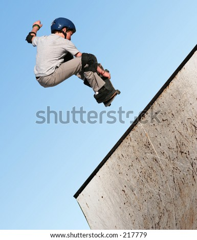 Boy skateboarding - stock photo