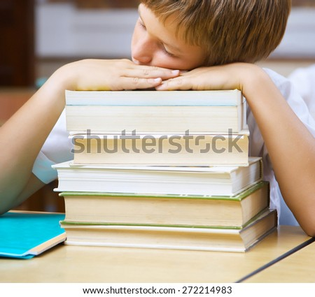 Boy Sleeping on the School Desk - stock photo