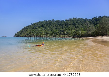 Boy snorkeling in the ocean, Phayam island, Thailand  - stock photo