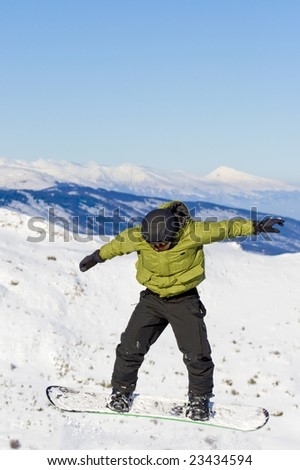boy snowboarding caught in a jump - stock photo