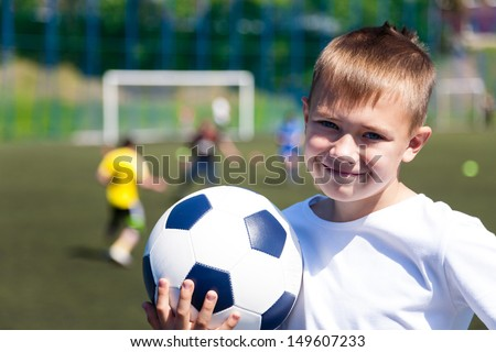 Boy soccer player at the stadium. - stock photo