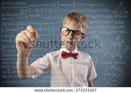boy solves a math problem - stock photo