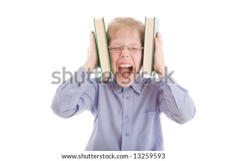 Boy squeeze head by two books and scream. Isolated on white background. Conceptual image about modern overflow of information. - stock photo