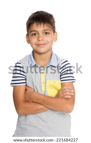 Boy standing with his arms crossed. Six years. - stock photo