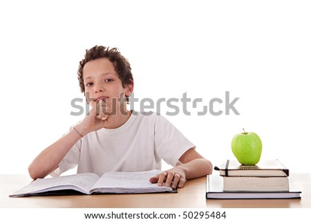 boy studying and thinking, along with one on apple top of some books, isolated on white background - stock photo