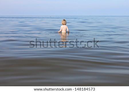 Boy swimming in sea - stock photo