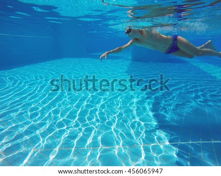 boy swimming in the pool - stock photo