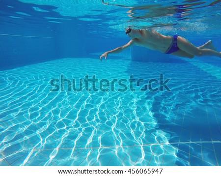 boy swimming in the pool - stock photo