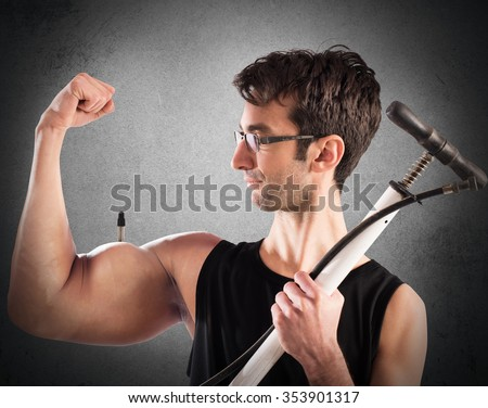 Boy swollen arm muscles with a pump - stock photo
