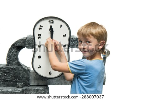 Boy takes the arrows on the clock - stock photo