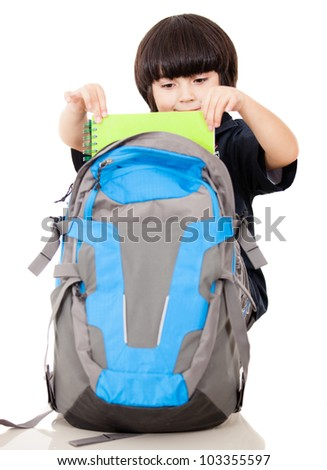 Boy taking notebooks out of school backpack - isolated over a white background - stock photo