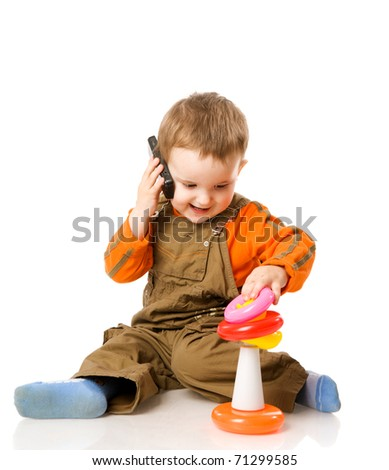 boy talking on phote playing with pyramid isolated - stock photo