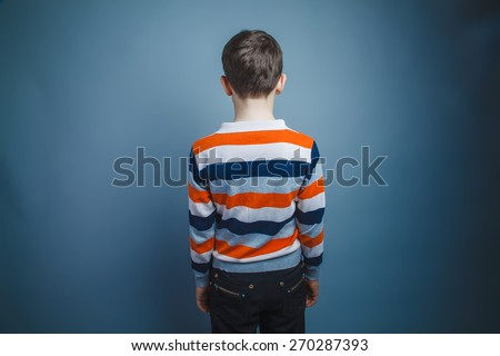 boy teenager European appearance Brown turned his back - stock photo