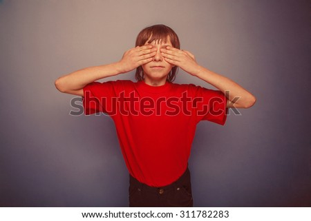 boy, teenager, twelve years in the red T-shirt, eyes closed hands retro - stock photo