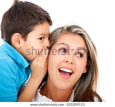 Boy telling his mother a family secret - isolated over a white background - stock photo