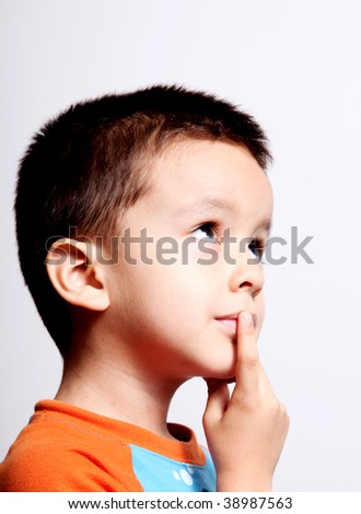 boy thinking and looking up over white background - stock photo