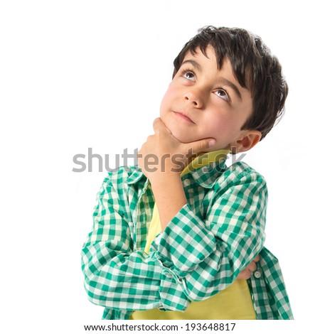 Boy thinking over white background  - stock photo