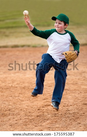 Boy throws baseball during practice - stock photo