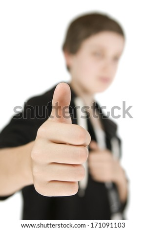 boy thumb up serious - stock photo