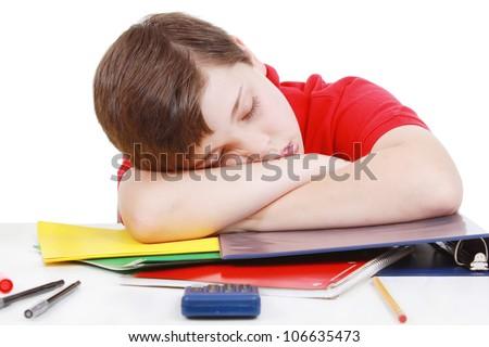 Boy tired of school work - stock photo