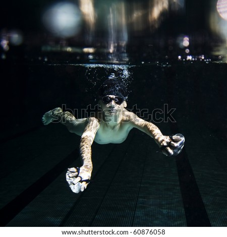 Boy training breast-stroke - stock photo