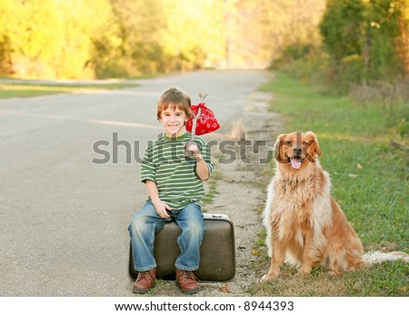 Boy Traveling with Dog - stock photo
